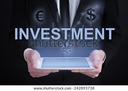 businessman holding a tablet PC with the projection of  investment conceptand graphs of financial growth financial growth. char. data analysis. statistics - stock photo