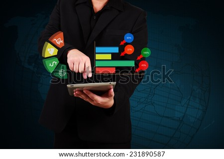 businessman holding a tablet showing business graph on virtual screen