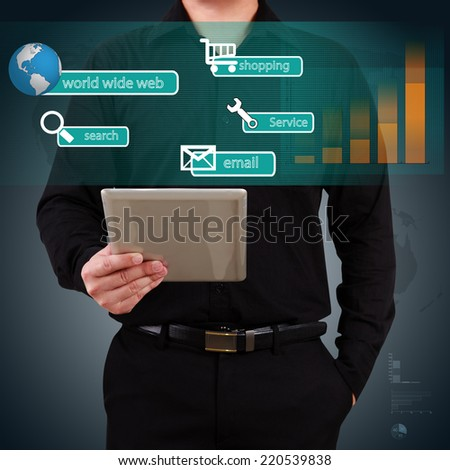 Businessman holding a tablet showing icon application on virtual screen. Concept of online business. - stock photo