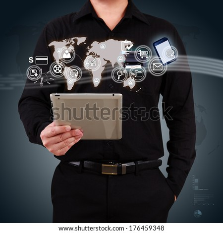 Businessman holding a tablet showing map and icon application on virtual screen. Concept of online business. - stock photo