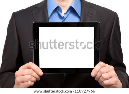 Businessman holding a tablet touch computer gadget with an insulated screen