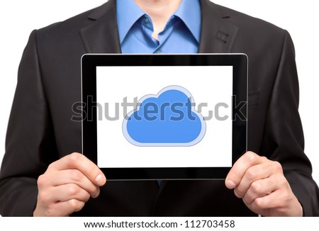 businessman holding a tablet touch computer gadget with the image of cloud - stock photo