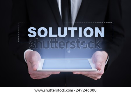 Businessman holding a tablet with business concept. solution. - stock photo
