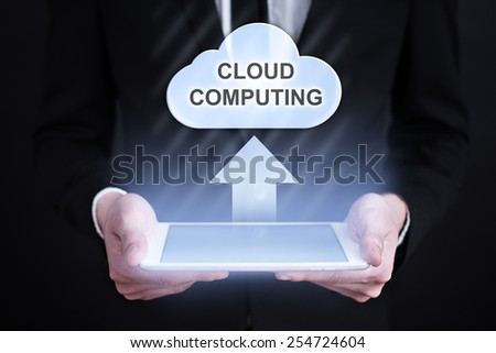 businessman holding a tablet with clouds computing concept. Internet concept. business concept. - stock photo