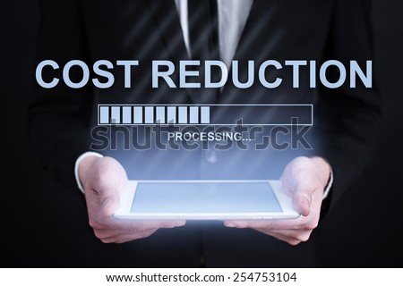 businessman holding a tablet with cost reduction loading bar  on the screen. Internet concept. business concept. - stock photo