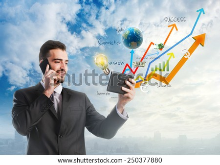Businessman holding a tablet with growing graphics over sky background - stock photo