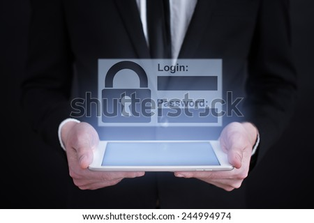 Businessman holding a tablet with internet security concept. information security. data security.