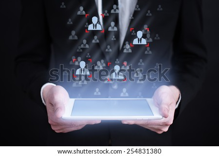 businessman holding a tablet with recruitment concept on the screen. Internet concept. business concept. - stock photo
