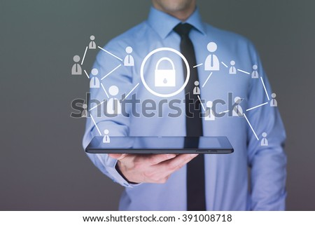 Businessman holding a tablet. with touch screen interface and cyber security concept .  - stock photo
