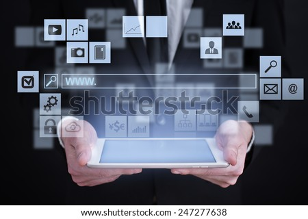 Businessman holding a tablet. with touch screen interface and search line. www surfing. internet concept. - stock photo