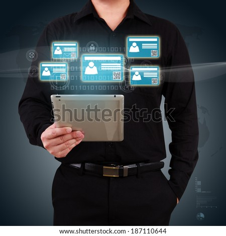 Businessman holding a tablet with virtual card and community icons. Concept of business communication. - stock photo
