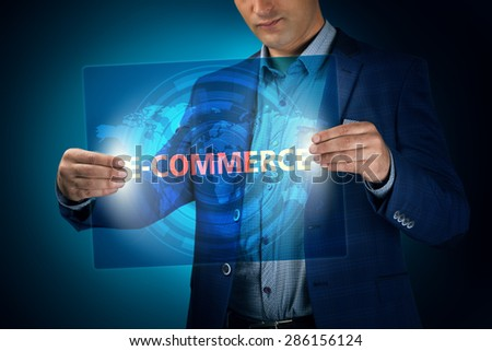 Businessman holding a transparent screen with an inscription a e-commerce. Business, technology, internet and networking concept. - stock photo