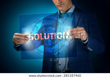 Businessman holding a transparent screen with an inscription a solution. Business, technology, internet and networking concept. - stock photo