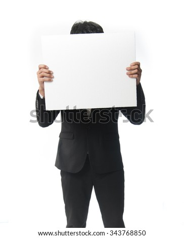 businessman holding a white board
