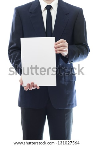 Businessman holding a white piece of paper with empty space for advertisement or information