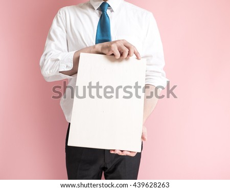 Businessman holding a wooden board