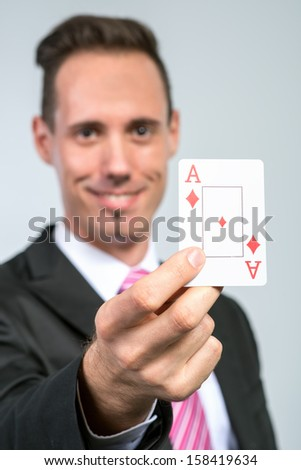businessman holding ace cards