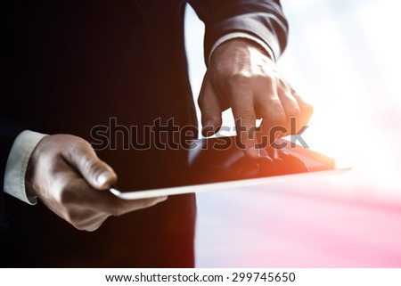 businessman holding and pushing digital  touch pad - stock photo