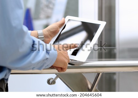 Businessman holding  and using the digital tablet - stock photo