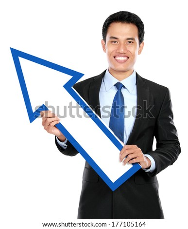 Businessman holding arrow up on white background