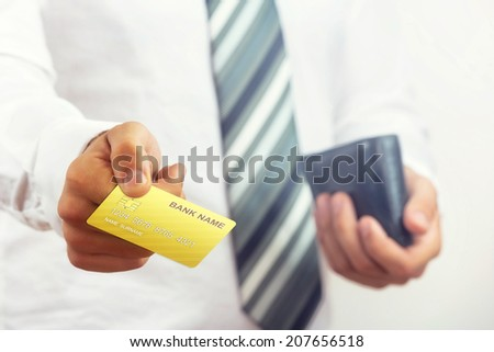 Businessman holding bank card. - stock photo
