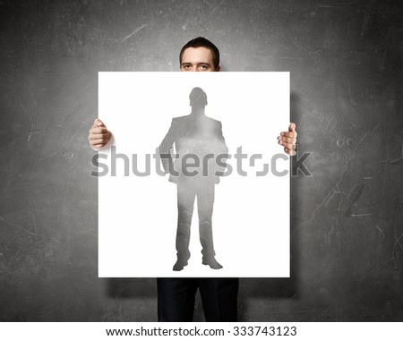 Businessman holding banner with business leadership concepts