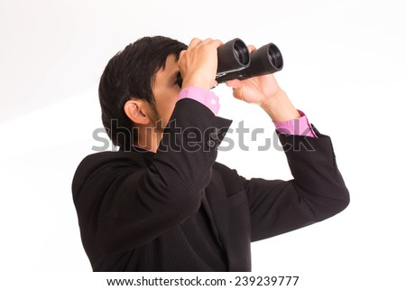 Businessman holding binoculars for search and check his business