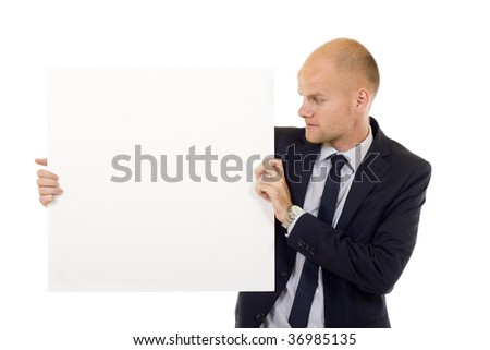 Businessman holding blank board for your presentation messages