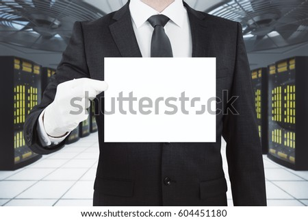 Businessman holding blank business card in server room. Mock up, 3D Rendering