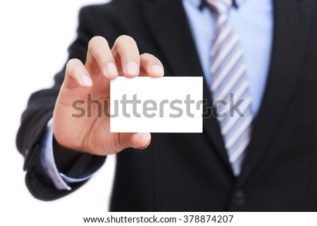 Businessman holding blank business card on white background