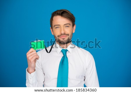 Businessman holding blank businesscard id card on blue - stock photo
