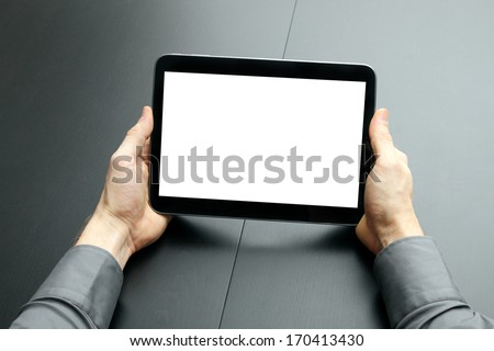 businessman holding blank digital tablet - stock photo