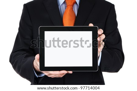 Businessman holding blank digital tablet with clipping path for the screen - stock photo