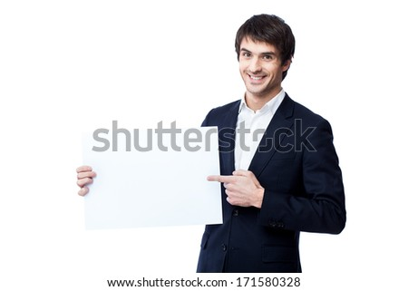 Businessman holding blank isolated on white - stock photo