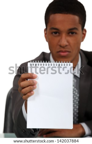 Businessman holding blank note pad - stock photo