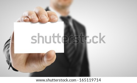 businessman holding blank paper visit card - stock photo