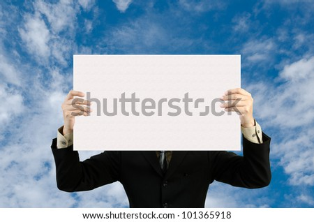 businessman holding blank sign  in sky - stock photo