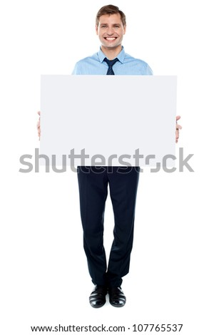 Businessman holding blank white billboard, full length portrait