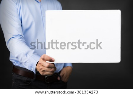 Businessman holding blank white board for copy space