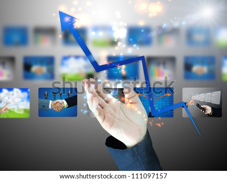 Businessman holding business graph