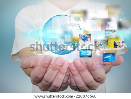 Businessman holding business world. - stock photo
