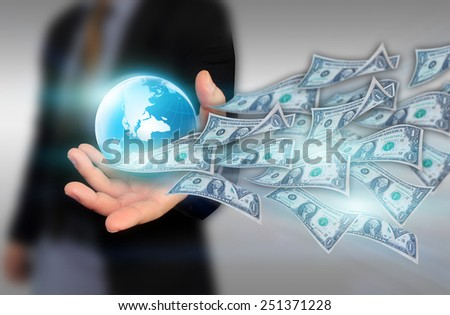 Businessman holding  business world with dollar - stock photo