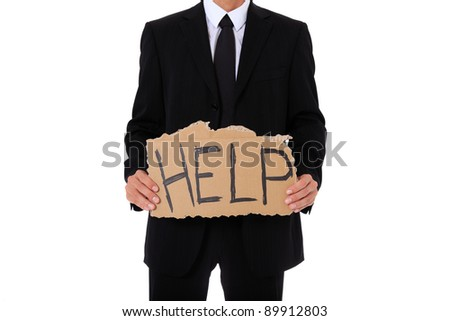 Businessman holding cardboard sign showing the term help. All on white background. - stock photo