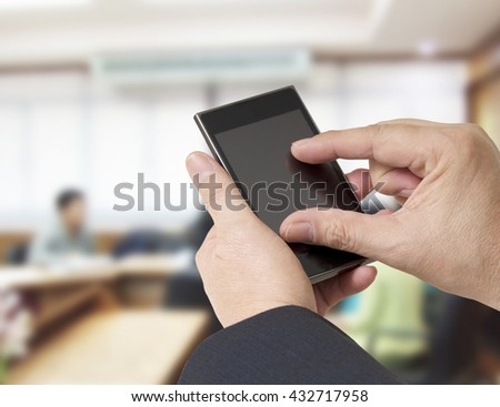 businessman holding cellphone and touch to connect internet