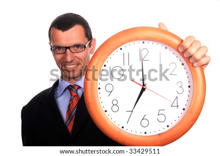 businessman holding clock over white background - stock photo