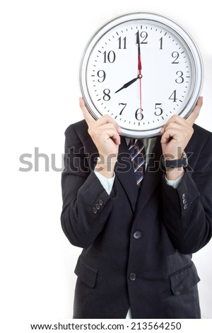 Businessman  holding clock  to show time to you