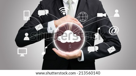 Businessman holding cloud computing network on gray background - stock photo