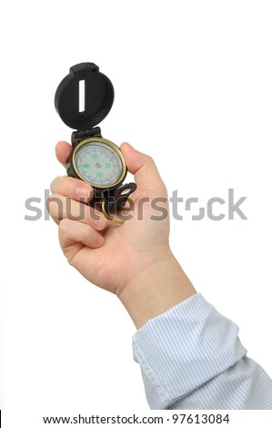 Businessman holding compass - stock photo