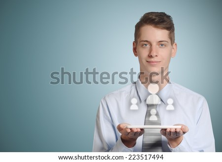 Businessman holding computer tablet with social media people icons in hands - stock photo
