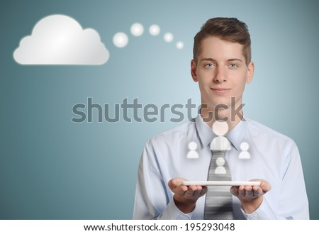 Businessman holding computer tablet with social media people icons in the cloud - stock photo